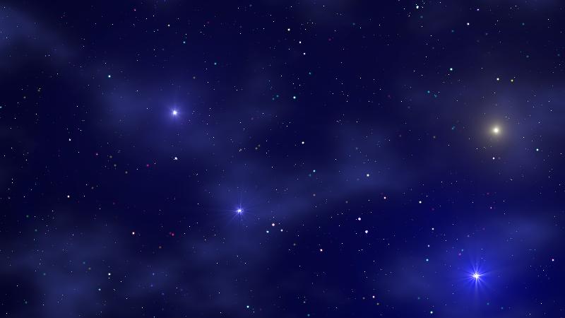 Wisps of dusty reflection nebulae surround several bright stars