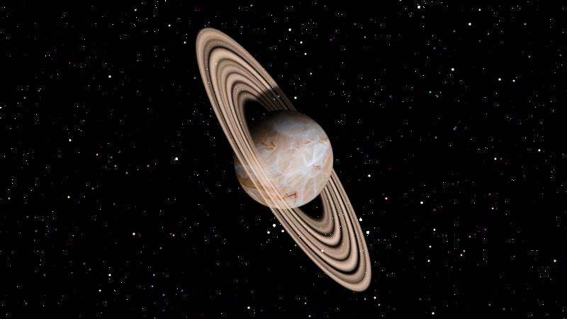 Our ringed planet floats amongst the stars.  Because the rings are not fully opaque, stars shine through them.
